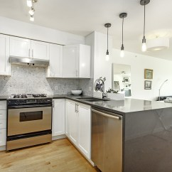 Kitchen Cabinets Glass Doors Islands For Sale Small Penthouse Apartment In Vancouver With A Space-saving ...