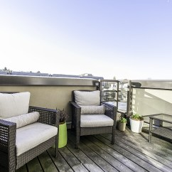 Eames Style Plastic Chair French Provincial And Ottoman Small Penthouse Apartment In Vancouver With A Space-saving Design
