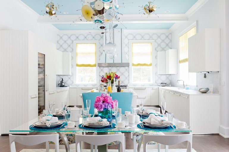 Blue ceiling adds to the appeal of the exquisite contemporary dining space [Photography: Rikki Snyder]