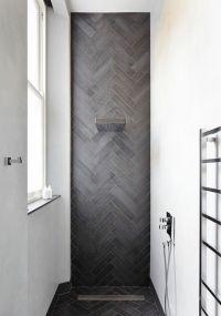 Contemporary shower featuring herringbone tile - Decoist