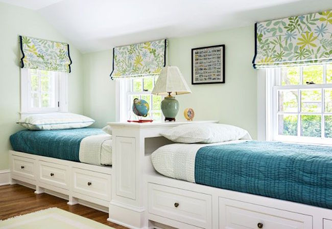 View In Gallery Two Twin Beds Along One Wall With Extra Storage