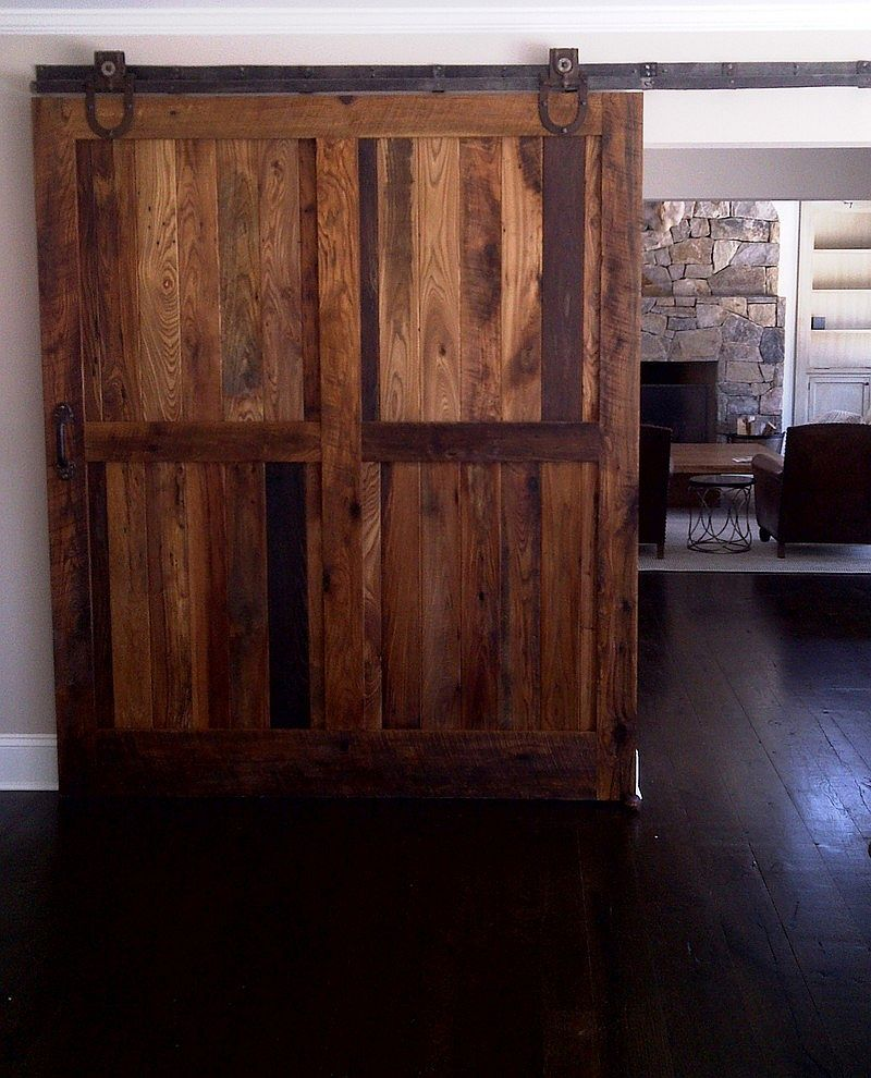 Sliding barn doors made from reclaimed chestnut lumber for