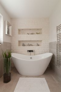 Split-face stone tiles create a textural accent wall in ...