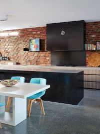 Exposed brick wall adds character and texture to the ...