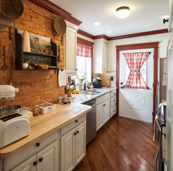 Farmhouse Kitchen With Antique Shelf And Brick Wall