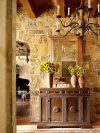 Stone walls and custom decor give the entry a Tuscan ...