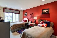 Baseball themed kids' bedroom with a striking red accent ...
