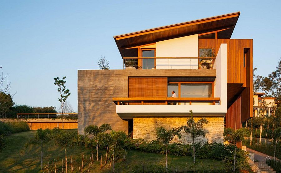 Expansive Holiday Home Unites Stone Concrete and Timber in Style