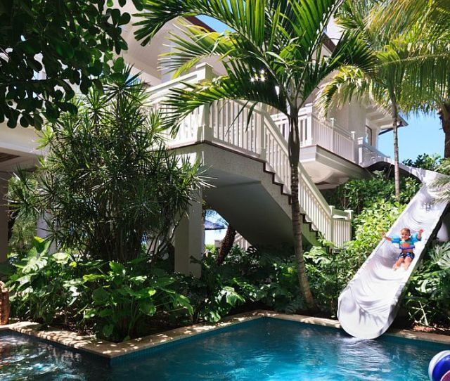 Custom Beachfront Residence Features A Slide That Leads To The Pool Design Bcb