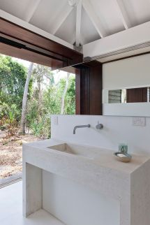 Small Tropical-style Beach House Opens World