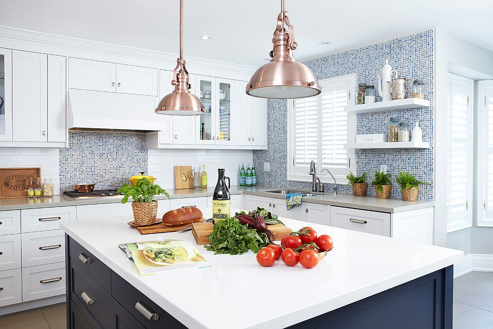 Copper pendants add glitter to the kitchen in white and navy blue [Design: Sealy Design]