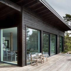 Japanese Inspired Living Room How To Decorate A Long Narrow With Fireplace Modern Scandinavian Log Cabin Set On Beautiful Baltic ...