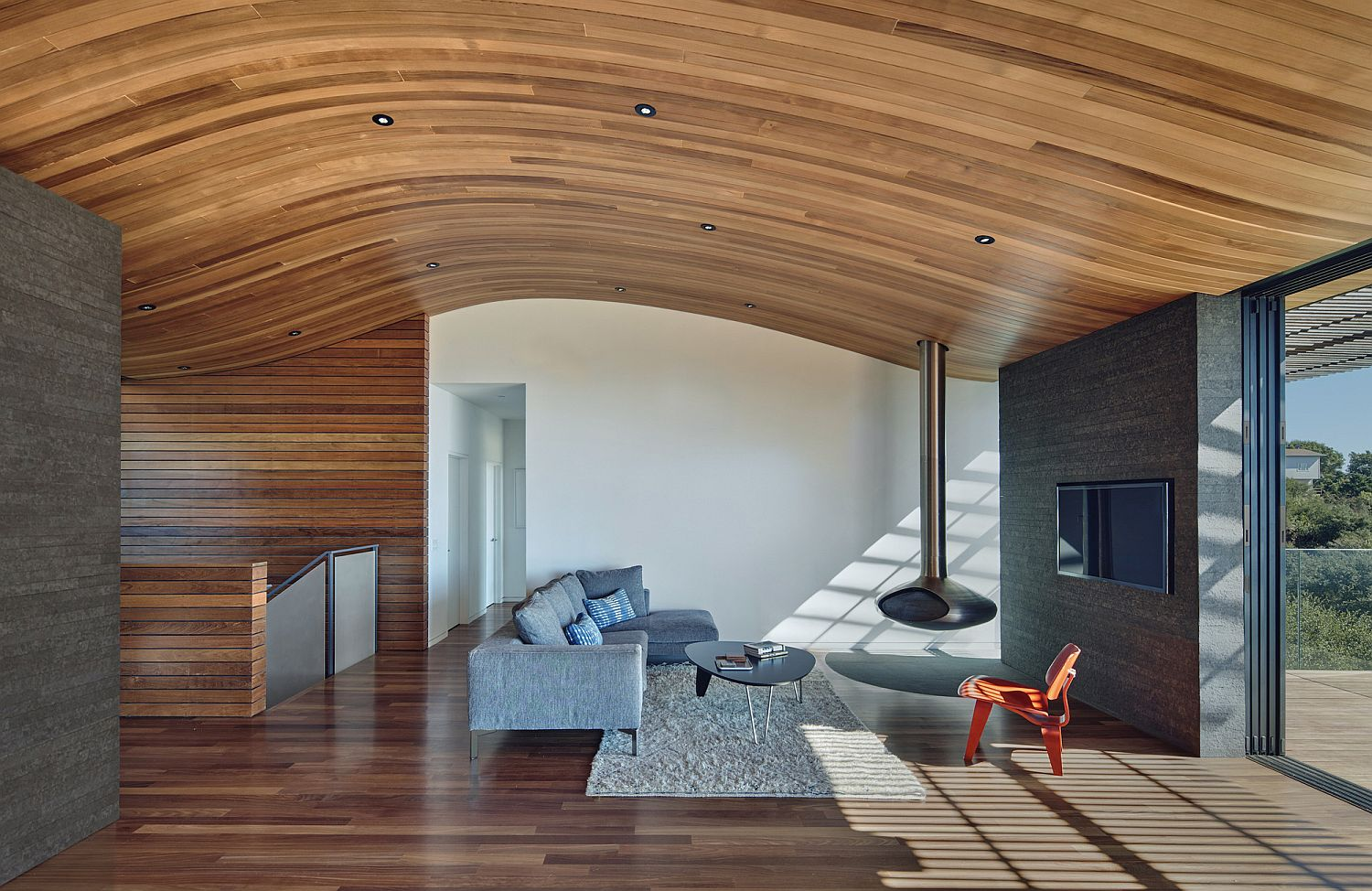 Wood Tube and Curved Ceiling Shape Skyline House Atop