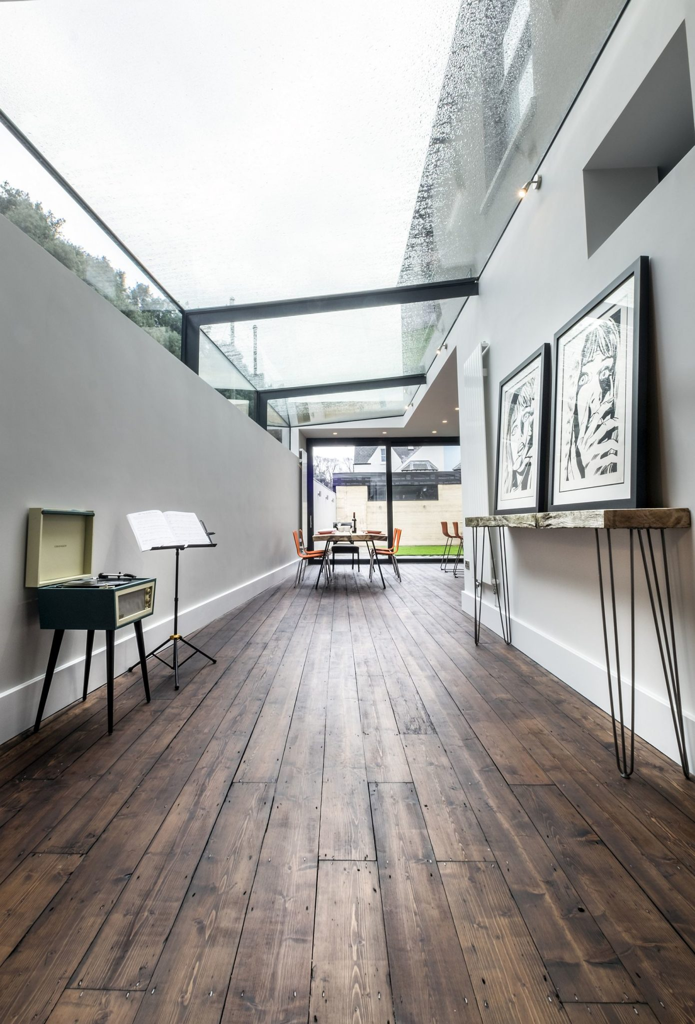 contemporary kitchen table suspended shelves modern revamp involving a glass roof transforms this dark ...