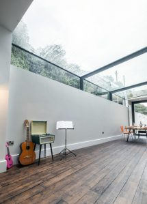 Modern Revamp Involving Glass Roof Transforms Dark