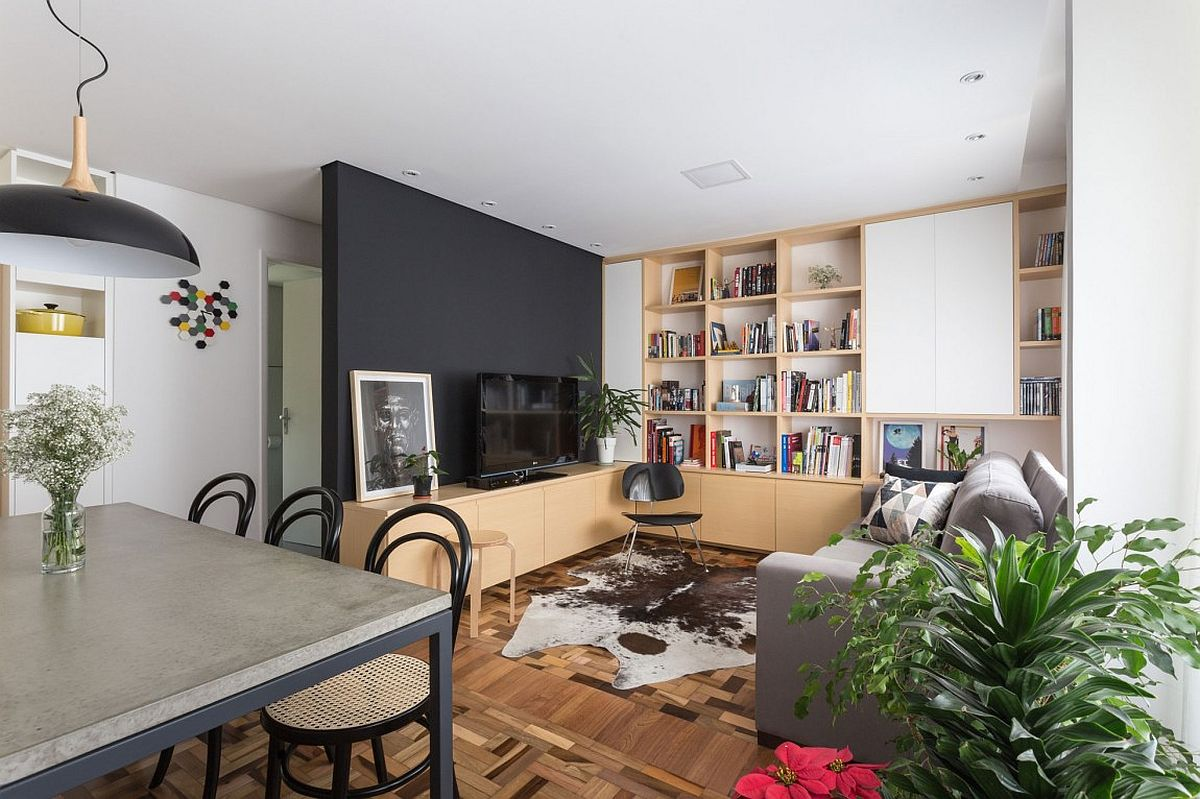 small living room storage rooms with dark hardwood floors 2 50 tiny apartment and shelving ideas that work for everyone view in gallery entertainment unit also contains space tufted seats lower level wooden cabinets