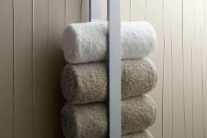 Contemporary Floating Bathroom Towel Storage Design