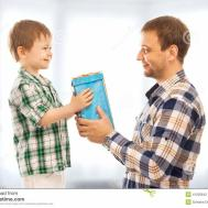 Happy Son Gives His Father Gift Stock