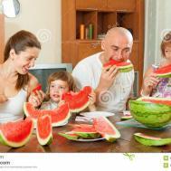 Multigeneration Family Eating Watermelon Royalty