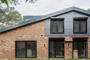 Nestled Nature Edge 1970s Brick Dwelling Gets