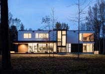Polished Charlotte Home Overlooks Lush Greenery