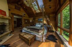Rustic Master Bedroom Stone Fireplace Skylight