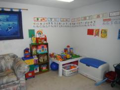 Whiite Chair Corner Playroom Ideas Book Shelves