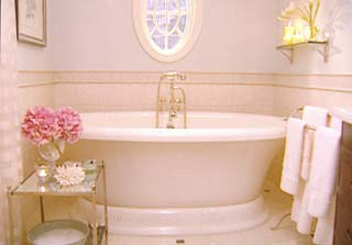 bathrooms - bath tub  bathroom from Room Service  freestanding tub, mirrored tiered table and window.