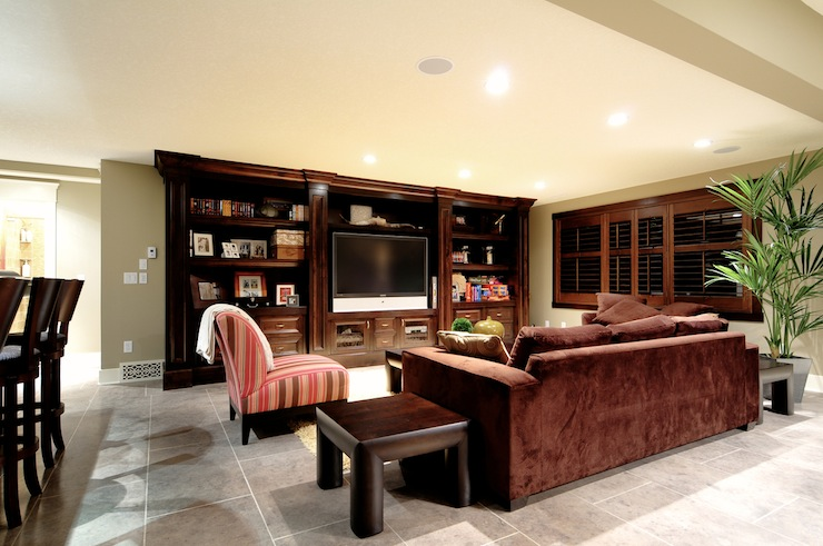 Basement family room with built in dark cabinetry