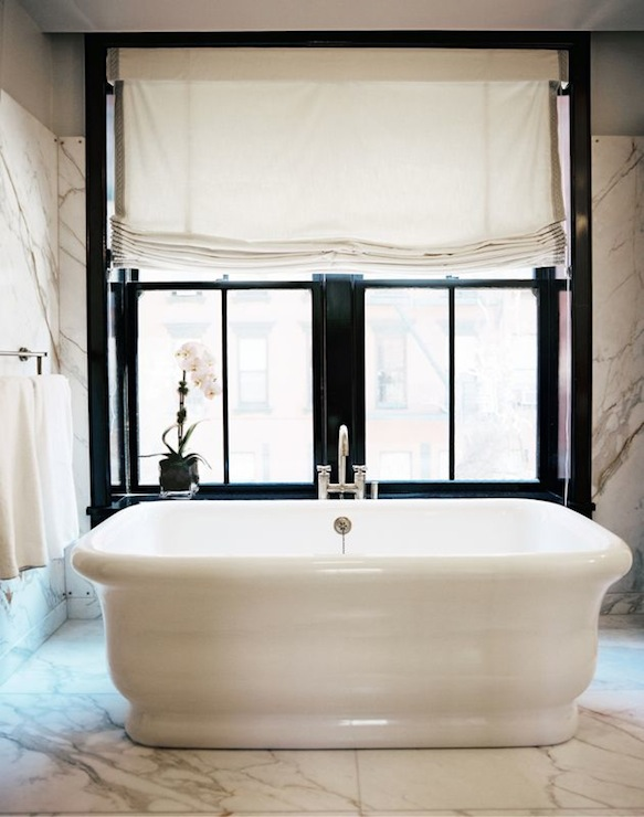 bathrooms - glossy black moldings white soaking tub calcutta gold marble tiles floor walls polished nickel faucet orchid ivory silk roman shade