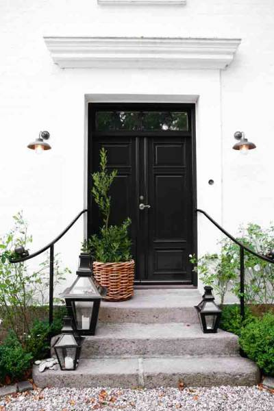 home exteriors - black doors black lanterns  Birgitta Wolfgang  Gorgeous home exterior with glossy black doors and black lanterns.