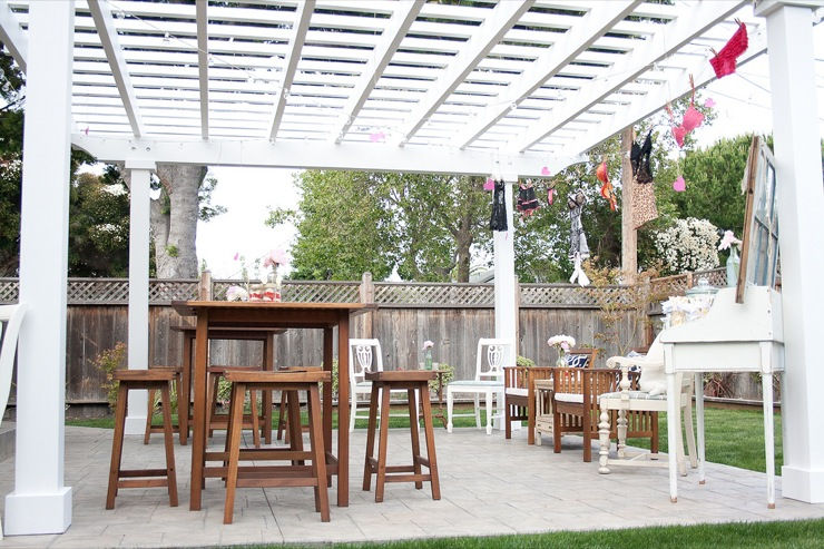 Patio With White Pergola And Wood Table