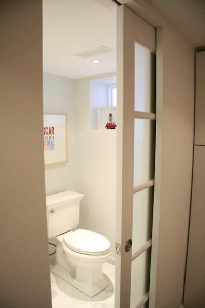 sliding pocket door bathroom Frosted Glass Pocket Door - Contemporary - bathroom - Benjamin Moore Paper White - Aubrey & Lindsay