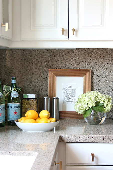 White KItchen Cabinets with Brass Knobs  Transitional