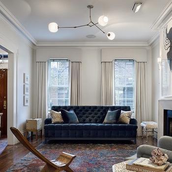 living room pouf furniture arrangement ideas fireplace blue velvet sofa design