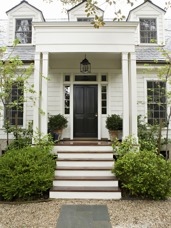 home exteriors - cape cod glossy black door  Lovely Cape Cod home with glossy black door.