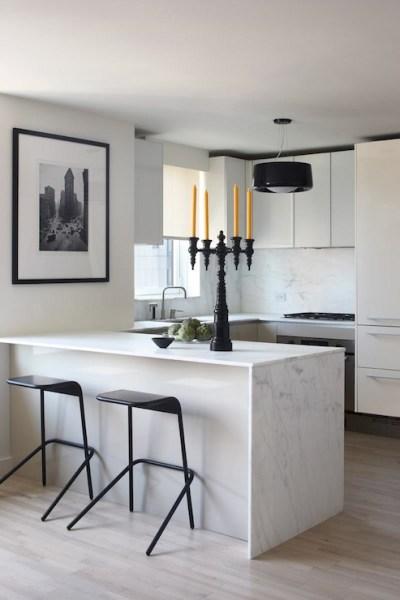 modern waterfall kitchen island countertop Waterfall Marble Kitchen Island - Modern - kitchen - Magdalena Keck Interior Design