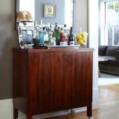 Living Room Wall Paint Finish Swivel Glider Chairs Urrutia Design Mid Century Modern Bar Cabinet