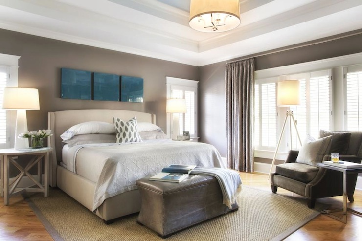 Gorgeous bedroom with tray ceiling accented with blue