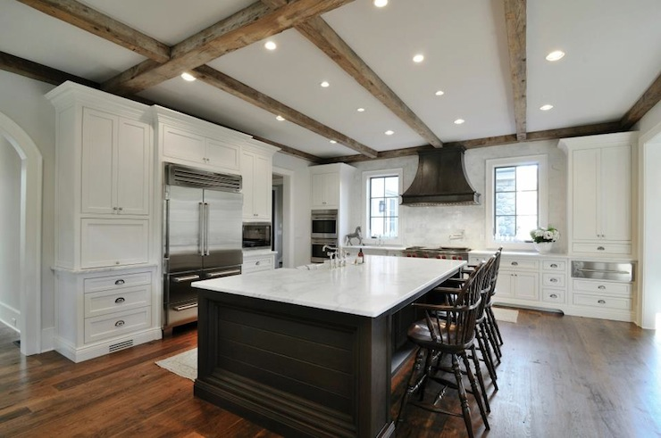 white kitchen island with seating wood flooring for zinc hood - transitional insidesign
