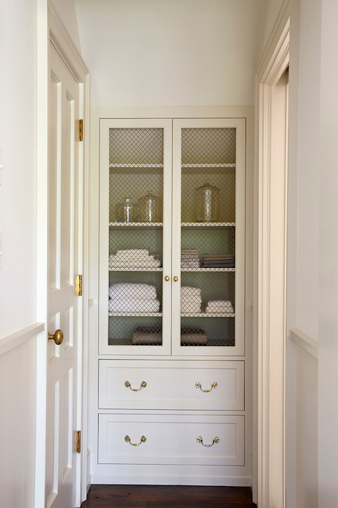 bathroom hall with glass front built in linen cabinets - cottage