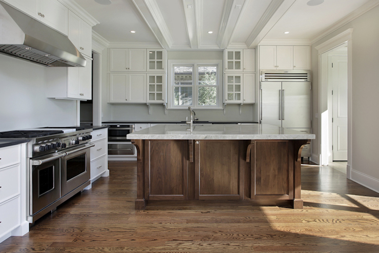 Two-tone Oak Kitchen Cabinets White Kitchen With Vaulted Ceiling Accented With Gray Wood