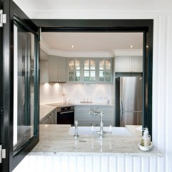 Kitchen Hood Vent Companies That Spray Paint Cabinets Range In Front Of Window Design Ideas