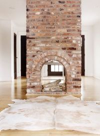 Double Sided Fireplace - Eclectic - living room