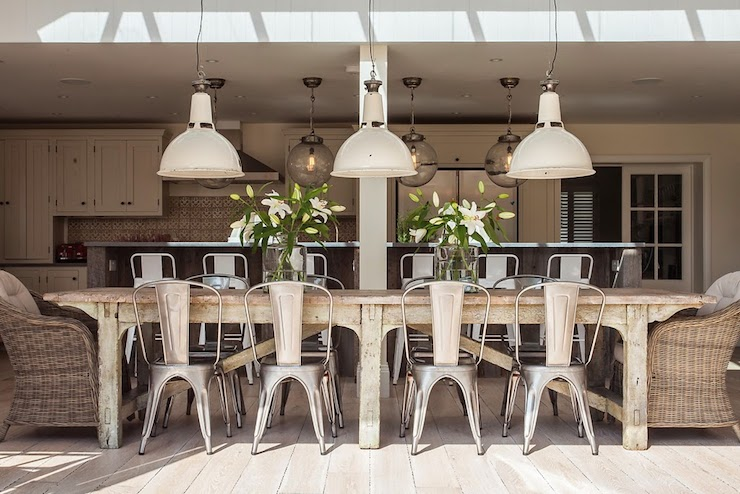 silver metal dining chairs swinging outdoors long table eclectic room shoot factory