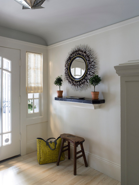 lighting above kitchen table jacksonville outdoor kitchens understated entryway features gray curved ceilings over ...