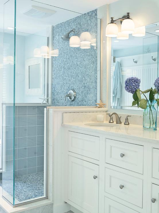shower with blue glass tiles