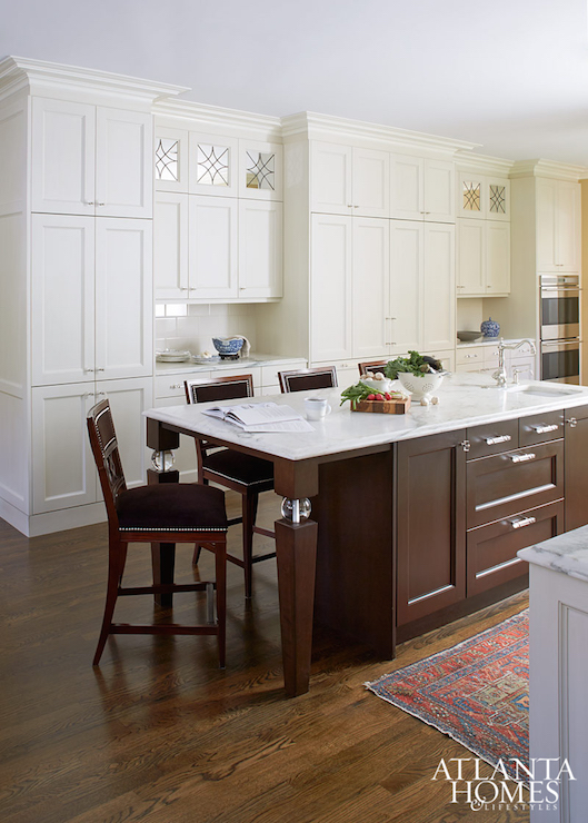 Brown Kitchen Island with White Marble Top  Traditional