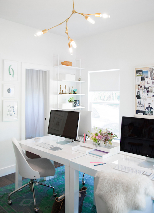 Home Office with Side by Side Desks in Front of Windows