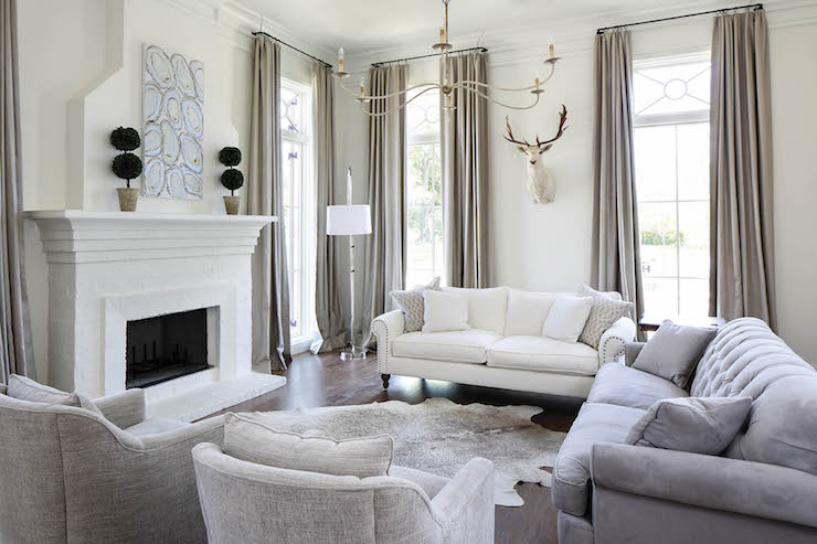 tufted leather sofa with rolled arms teen currey and co saxon chandelier - transitional living ...